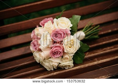 beautiful, fresh bridal bouquet of white and pink roses