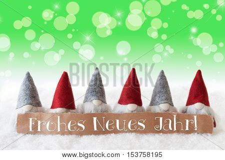 Label With German Text Frohes Neues Jahr Means Happy New Year. Christmas Greeting Card With Gnomes. Sparkling Bokeh And Green Background With Snow And Stars.
