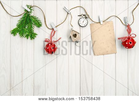 Christmas arrangement with greeting card. Christmas tree branches on bright wooden background