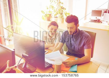 business, fail, startup and people concept - creative team with computer and papers in office