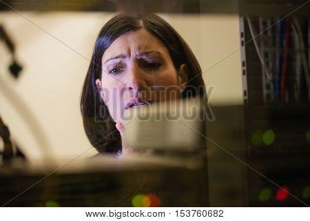 Upset technician working in server room