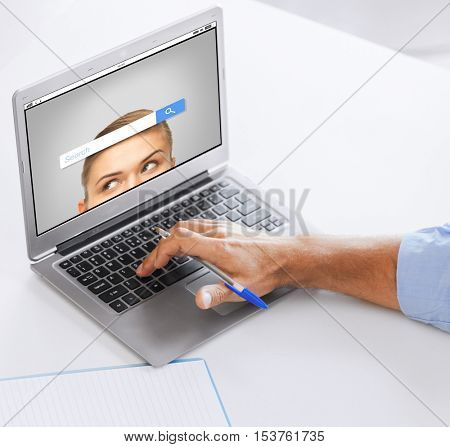 business, technology and people concept - close up of businessman with internet browser search bar on laptop computer screen working at office