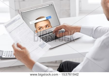 business, technology, multimedia and people concept - close up of businessman with internet browser search bar on laptop computer screen working at office