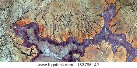 Abstract photography of landscapes of deserts of Africa from the air, river mauve