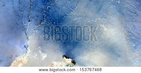 Abstract photography of landscapes of deserts of Africa from the air, allegory blue and white