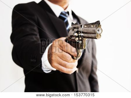 Asian businessman with gun in white background