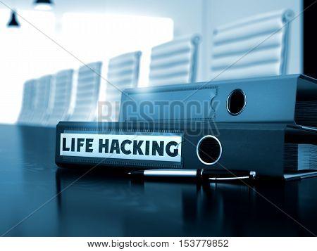 Life Hacking - Ring Binder on Black Desktop. Binder with Inscription Life Hacking on Working Desktop. 3D.
