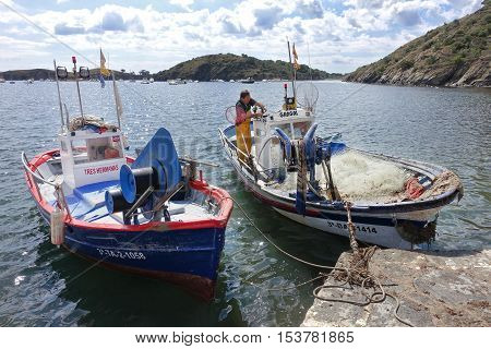 Cadaques Spain - June 16 2016: Mediterranean fishing boat at Portlligat bay in Cadaqueson Cap de Creus peninsula Catalonia Spain