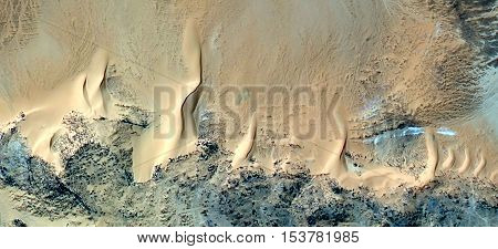 Abstract photography of landscapes of deserts of Africa from the air, yellow sand