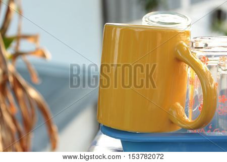 wate the yellow cup  Morning and breakfast concept