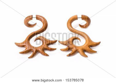 Earrings made of wood closeup on a white background