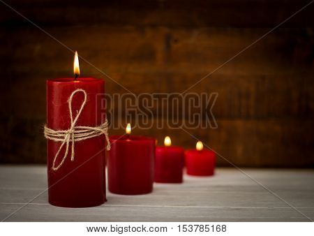 Red candles on wooden floor,Festive or spa concept ideas background