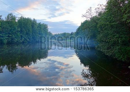River with trees on the shore in the evening