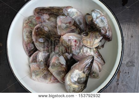 bowl with fish head for cooking fish soup