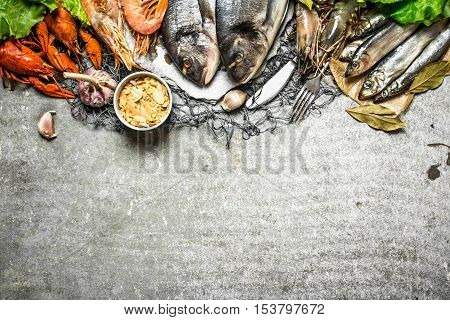 Assorted Shellfish And Spicy Shrimp On The Fishing Net.