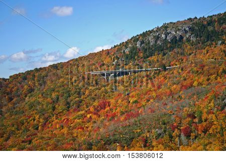 the viaduct of the Blue Ridge Parkway is visible amid fall foliage on Grandfather Mountain in North Carolina