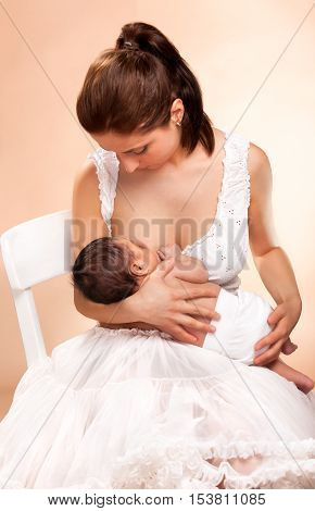 young beatiful mother breast feeding her child