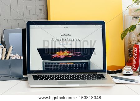 PARIS FRANCE - OCT 28 2016: Apple Computers website on new MacBook Pro Retina with OLED touch bar in a geek creative room showcasing new professional laptop - detail of Touch Bar with A touch of Genius advertising message of the new OLED screen