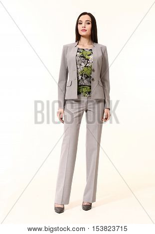 arabian business executive woman with straight hair style in official two pieces trousers jacket suit high heels shoes stand full body length isolated on white