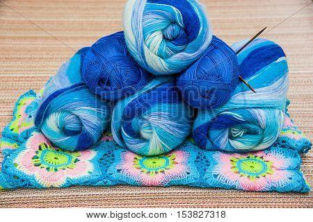 Balls of colored yarn. Multi-colored wool yarn in balls