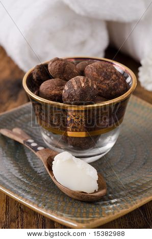 Shea Butter In A Spoon With Shea Nuts