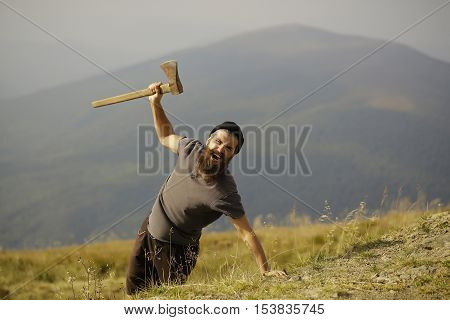 Bearded Man With Ax On Mountain