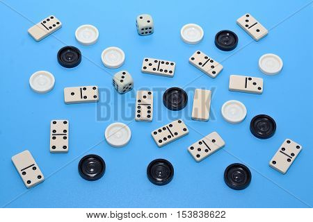 dominoes and checkers on blue background abstract