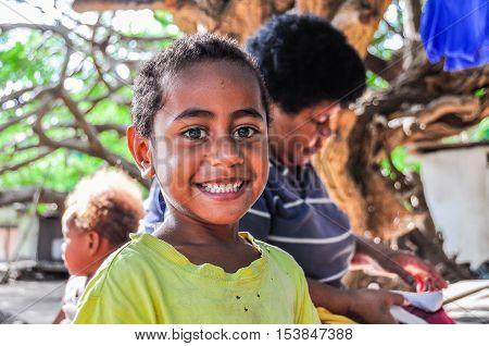 MANA ISLAND, FIJI - AUGUST 20, 2012: Smiling boy in a local village in Mana Island Fiji