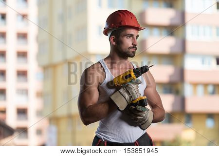 Portrait Of A Worker With Drill