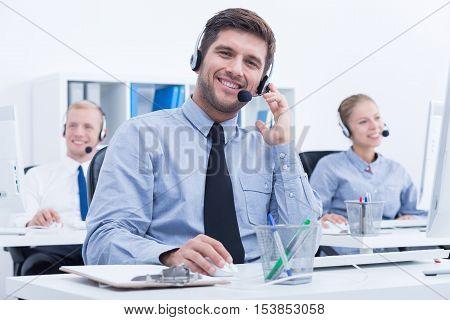 Businessman weraing headset working in customer service department
