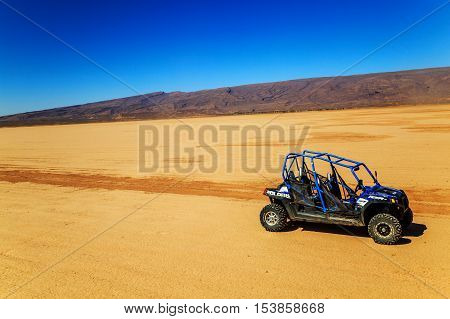 Merzouga Morocco - Feb 22 2016: blue Polaris RZR 800 with no pilot in Morocco desert near Merzouga. Merzouga is famous for its dunes the highest in Morocco.