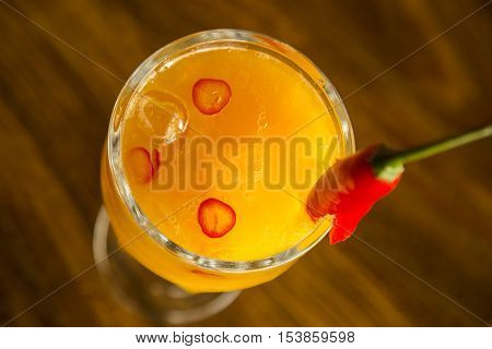 Mango Fruit Caipirinha With Red Pepper Of Brazil On Wooden Background