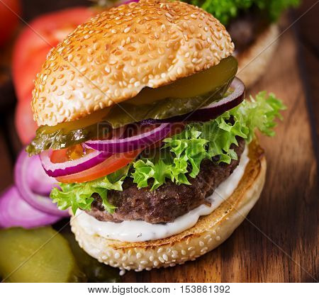Big Sandwich - Hamburger Burger With Beef, Pickles, Tomato And Tartar Sauce On Wooden Background.