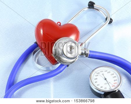 Medical Stethoscope Head And Red Toy Heart Lying On Cardiogram Chart Closeup.  Help, Prophylaxis, Di