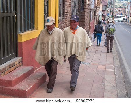Local Men In Ponchos