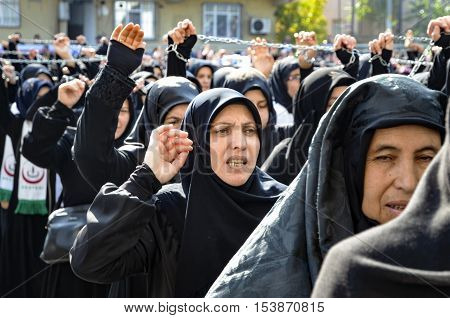 Istanbul Turkey - October 11 2016: Shia Muslim women shout Islamic slogans as they mourn during an Ashura procession. Turkish Shia Muslims mourning for Imam Hussain. Caferis take part in a mourning procession marking the day of Ashura in Istanbul's Kucukc