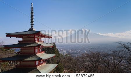 Mt. Fuji volcano viewed from behind red Chureito Pagoda, Japan during winter