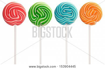 Red green blue and orange mini lollipops isolated on white. White swirls and white sticks.