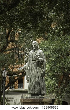 Statue in a Savannah square with live oak trees USA