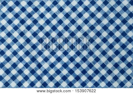 Fabric Texture Close Up of Blue and White Checkered Plaid Towel or Napkin Pattern Background.