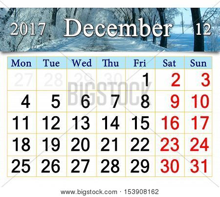 calendar for December 2017 with winter road and trees in hoar-frost like a tale