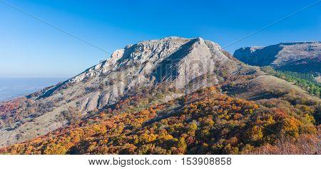 Bald Ivan mountain under morning light at autumn season - mountain pasture Demerdzhi Crimea Ukraine.