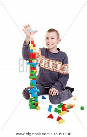 Child Bilding A High Tower