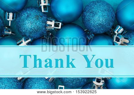 Thank you message Some bright blue sparkle and matte Christmas ball ornaments with text Thank you