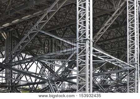 Modern metal structure of columns and trusses. Canopy-span construction.