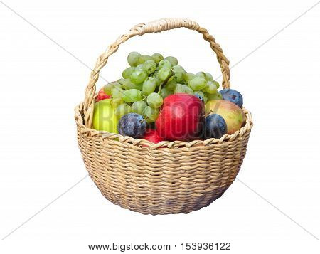Fresh Fruits Arranged In A Wicker Basket Isolated On White