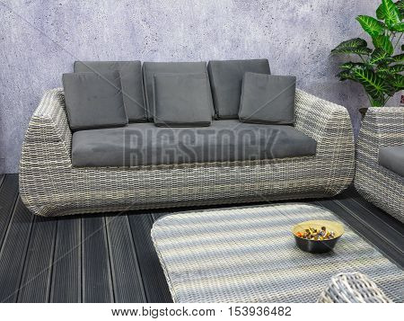 Modern gray sofa in a minimalism style interior design