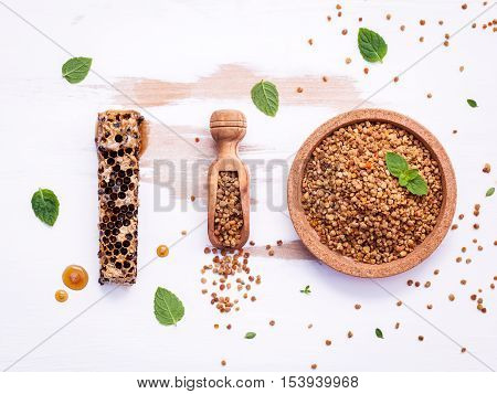 Raw Organic Bee Pollen On Shabby Wooden Board. Bee Pollen Granules And Propolis In Wooden Scoop. Hom