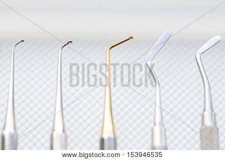 Close up photo of dental cavity filling instruments