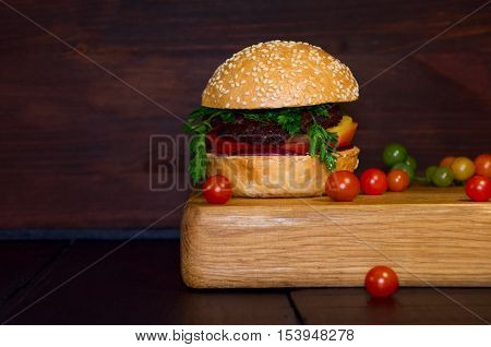 Big burger hamburger bun with beef and vegetables american sandwich closeup